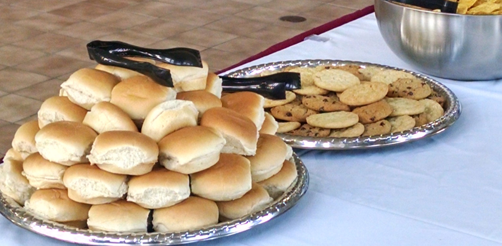 Assortment of dinner rolls, cookies and other delicious food