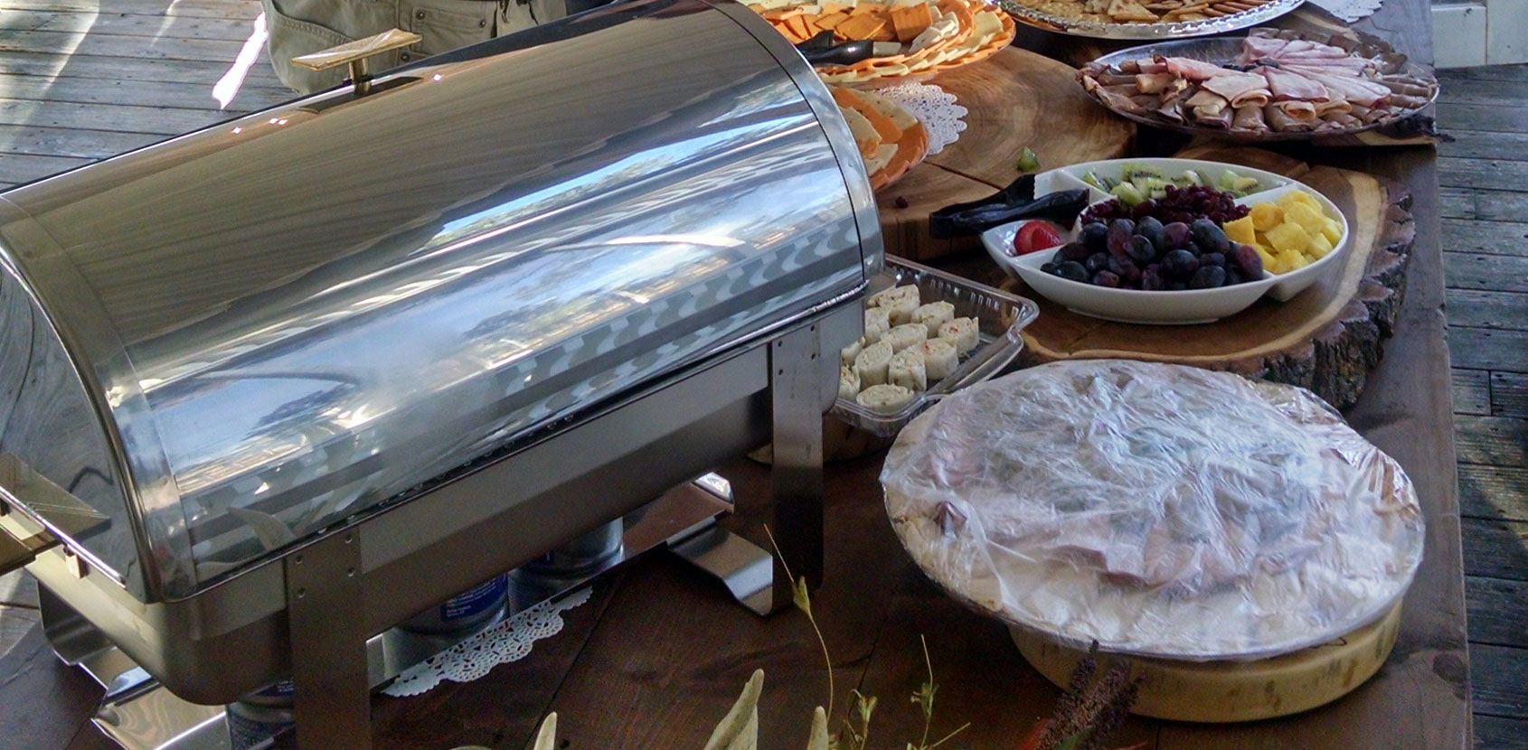 Catering food presentation with chafer, vegetable, fruit, cheese and meat trays and etcetera